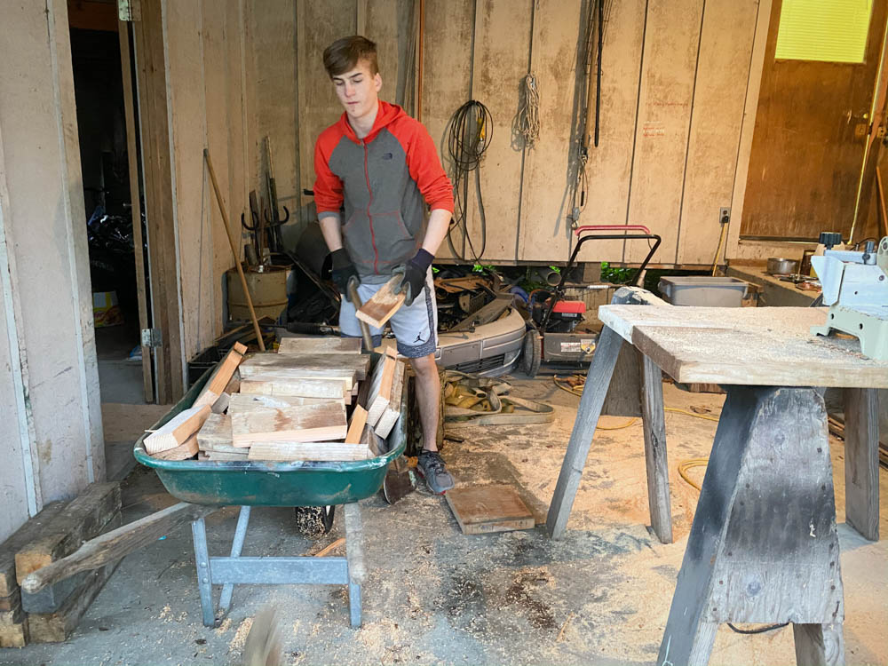 Hezekiah learns hard work by hauling wood for our woodstove.