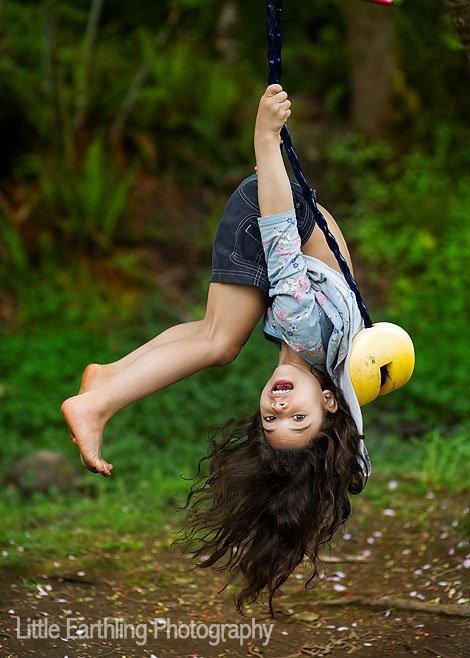 Avi hanging upsidedown in a swing
