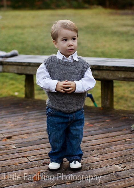 Apollo in handknit gray vest.