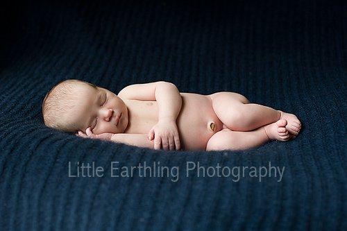 Newborn Apollo sleeping for his newborn photos.