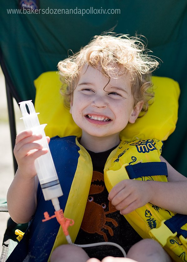 child being tube fed at the beach (g-tube)