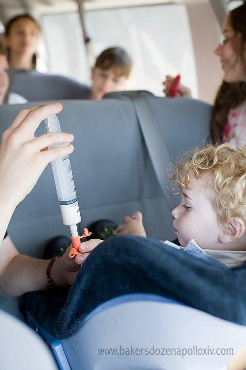 toddler being  tube fed in van