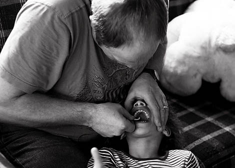 Having your child lie down while brushing their teeth makes it easier on everyone.