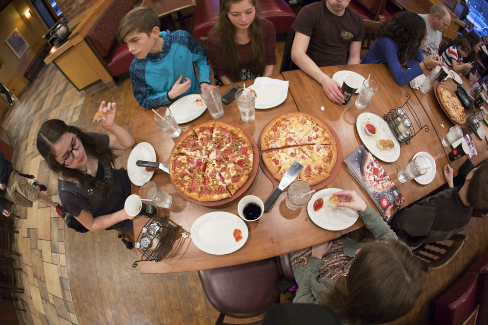Large family pizza night...sharing the love at Pizza Hut. The FREE Pizza Hut Book-it program is a fun way to afford homeschooling.