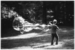 Boy making giant bubbles at the church campout.