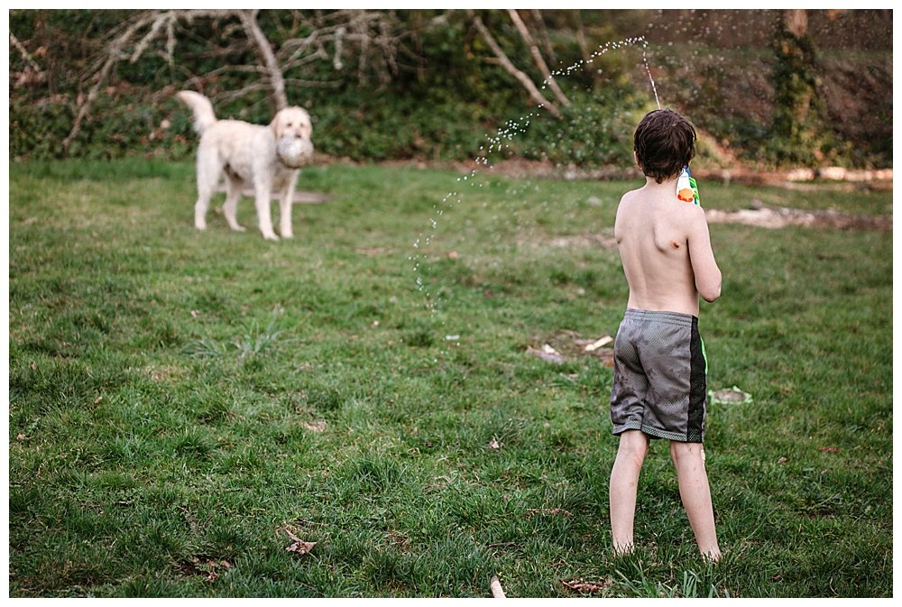 Apollo spraying Frodo with a water gun.