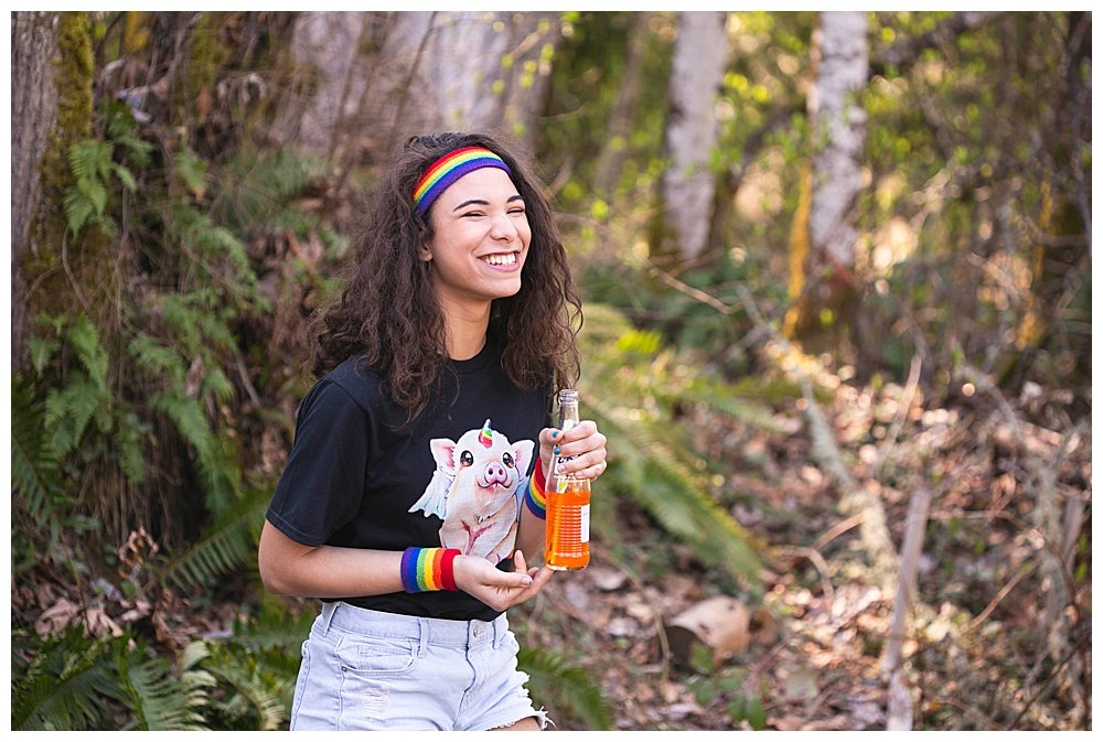 Avi with unipig shirt in the woods.