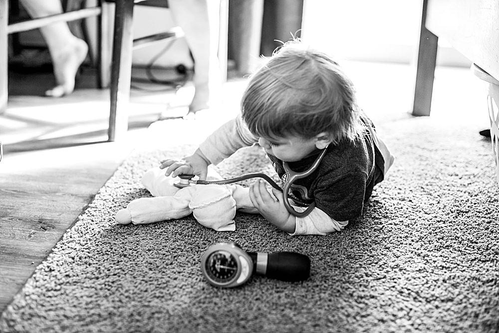 Percy examining doll during prenatal visit