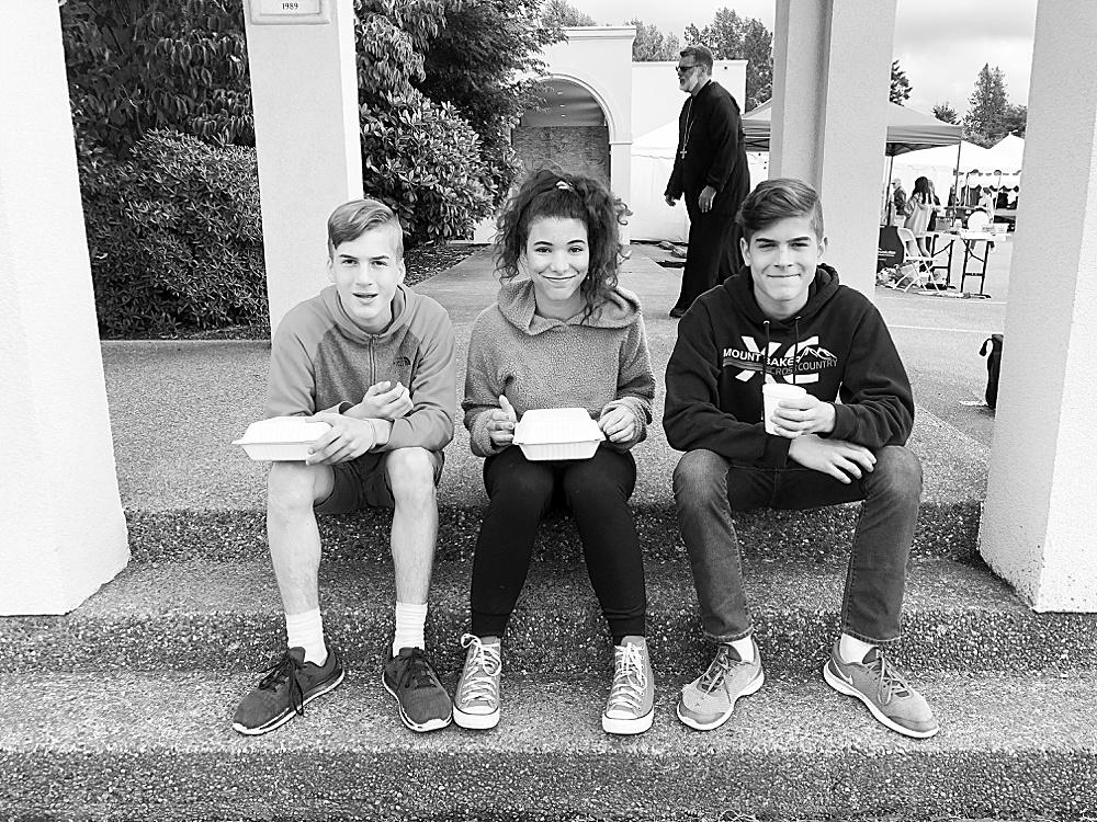 Hezekiah, Avi, and Tucker at the Greek Festival.