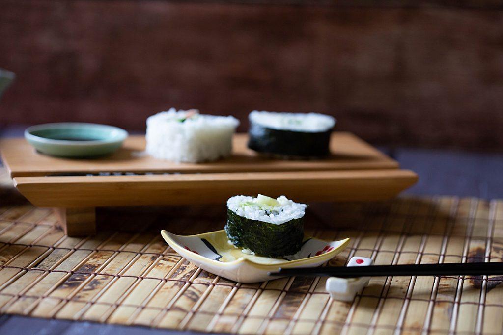 Sushi and tea on bamboo mat