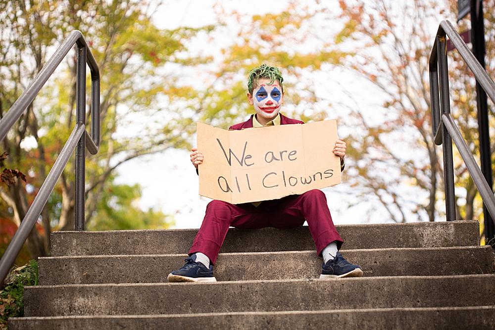 Kid dressed as joker in joker-inspired diy costume.