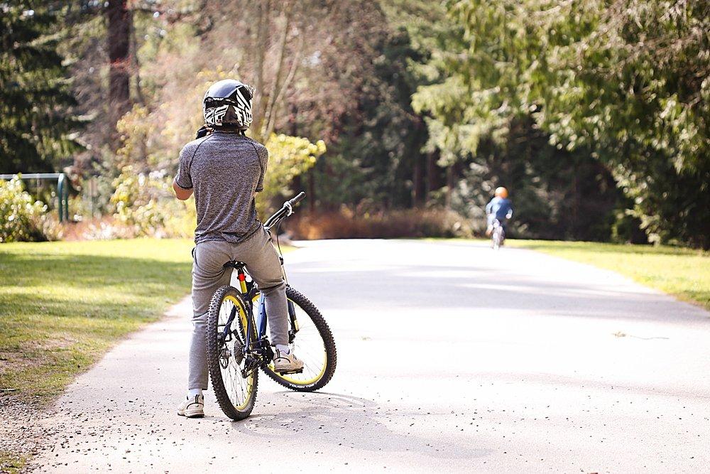 Mordecai riding a bike at Whatcom Falls Park.