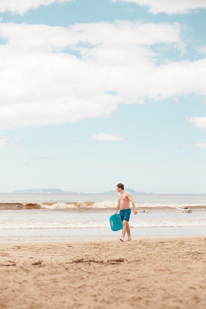 Judah on the beach in New Zealand.