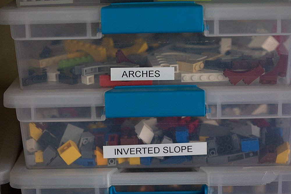Labeled Sterilite bins containing LEGO bricks.