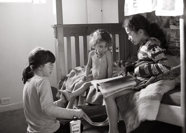 Jbuilee, Avi, and Apollo reading.