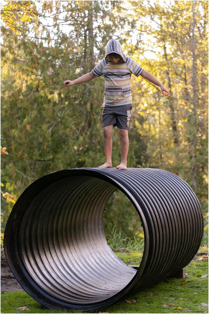 Apollo balancing on giant pipe.
