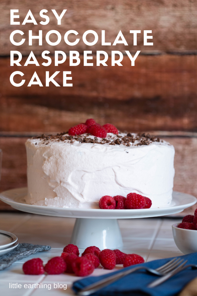 Easy Chocolate Cake Recipe with raspberry filling and whipped cream frosting.
