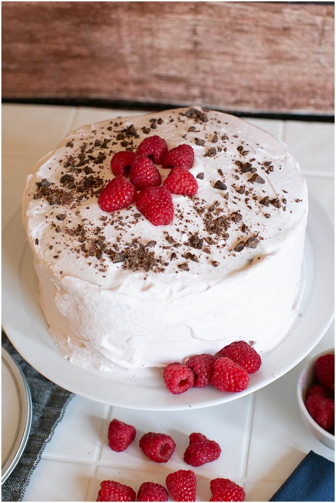 Easy chocolate cake filled with raspberries and whipped cream.