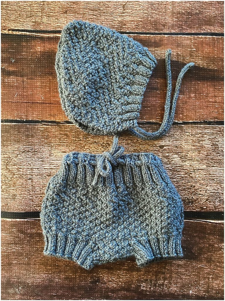 Hand knit bonnet and bloomers.
