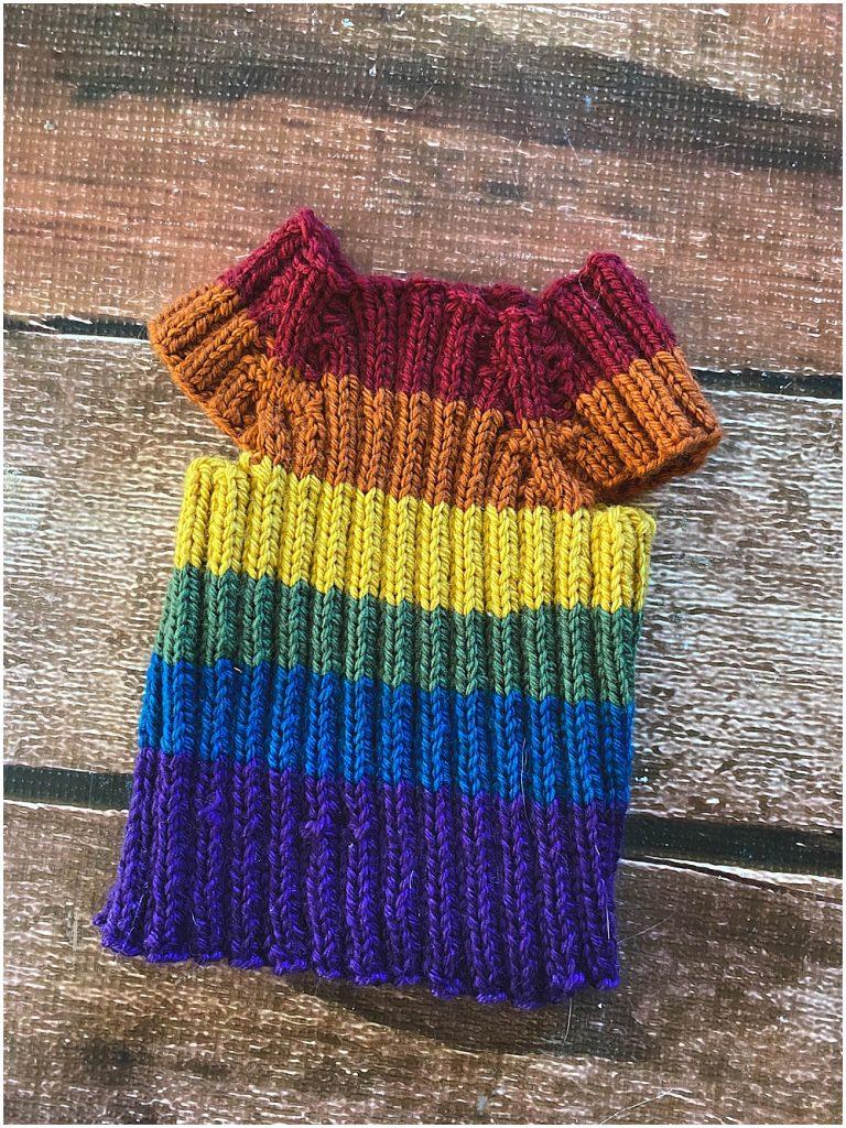 Handknit newborn rainbow vest.