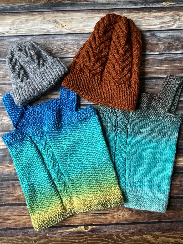 Milo Vests knit with yarn from The Blue Brick.