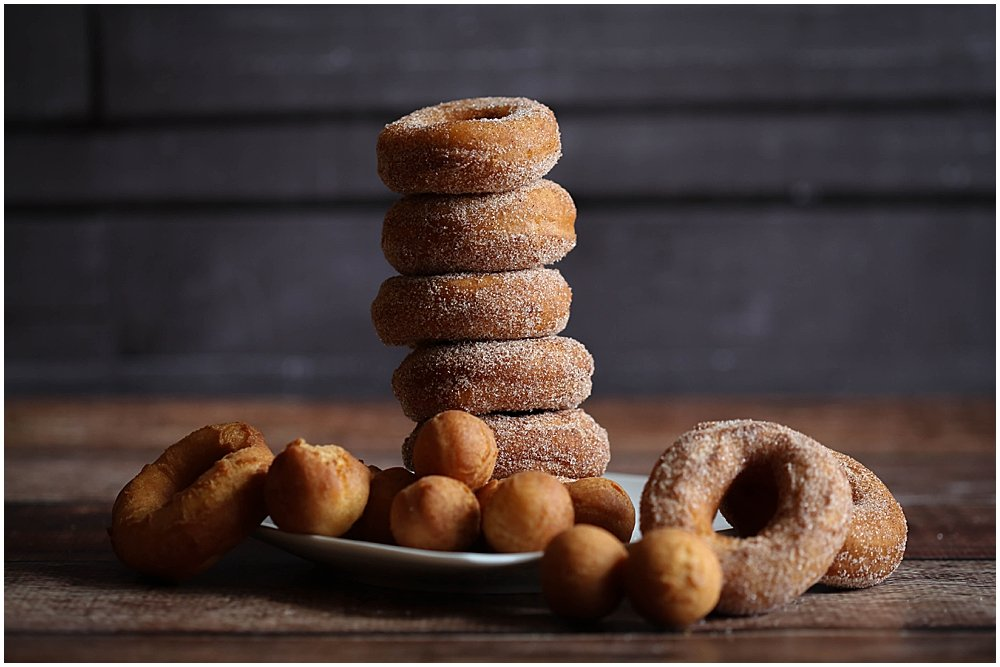 Traditional cake donut recipe. Tall stack of donuts and donut holes.