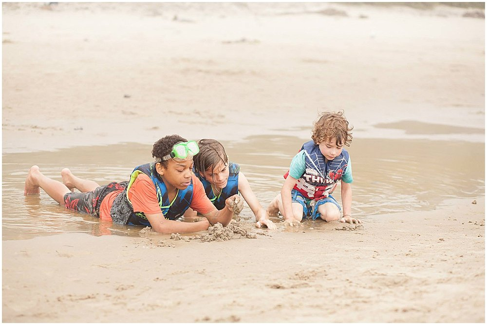 Three boys playing on the beach on the Oregon Coast.