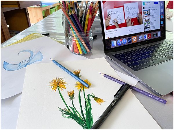 Watching YouTube drawing videos is a favorite way to homeschool art.