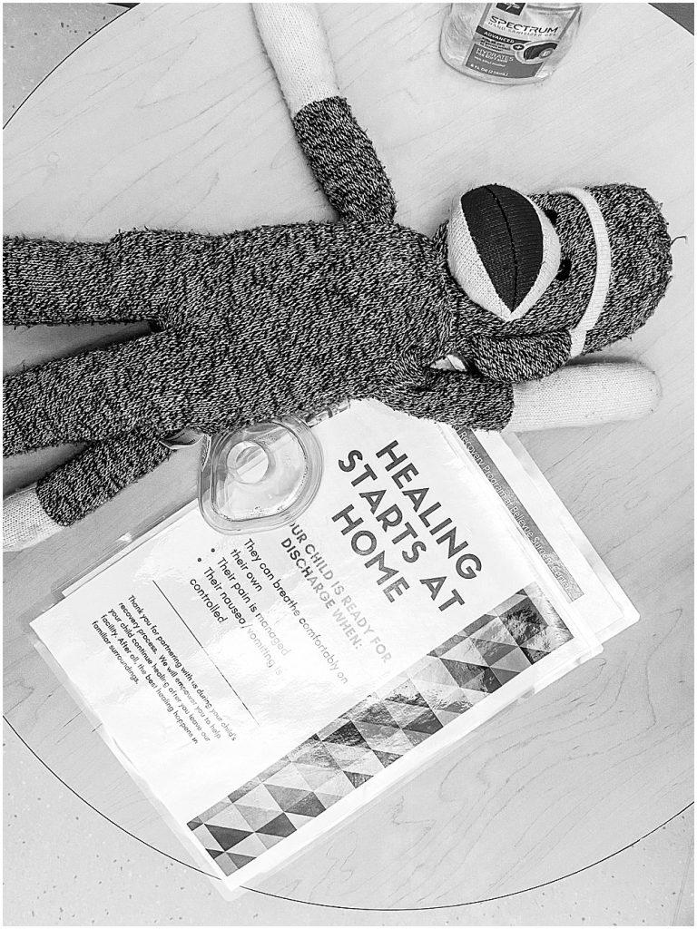 Sock monkey and mask in hospital.