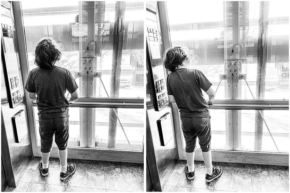 Boy in glass elevator at Bellevue Mall.